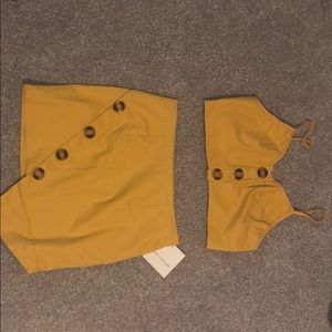 yellow two piece outfit